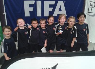 Jellybean Futsal team with trophy 2016